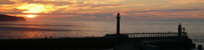 sunset over whitby piers